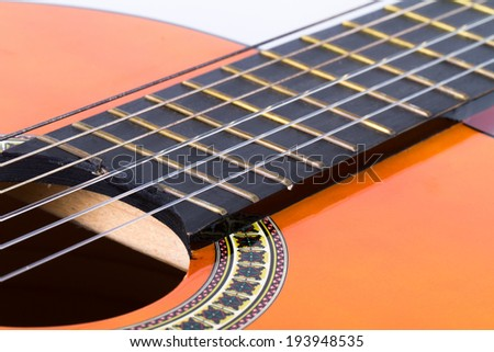 Detail view of classical acoustic guitar. - stock photo
