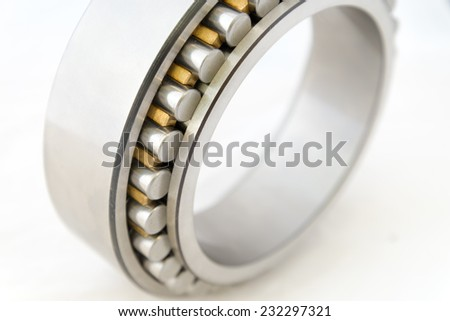 Detail view of cylindrical bearing on white background. - stock photo