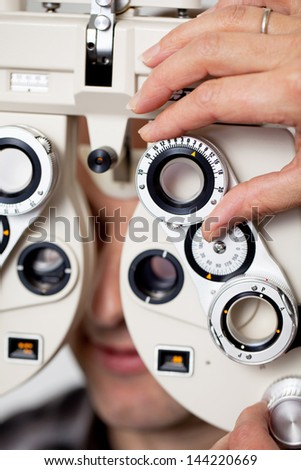 detail view of eyesight measurement in eye clinic