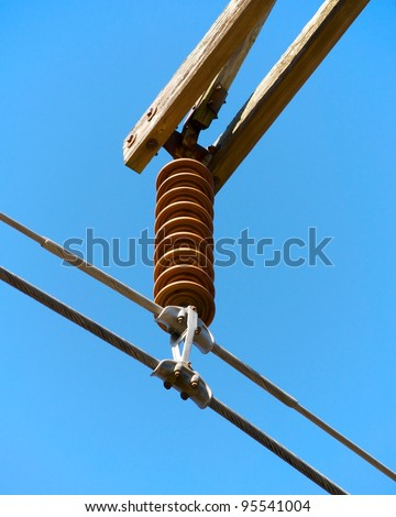 Detail view of high voltage wire and insulator.
