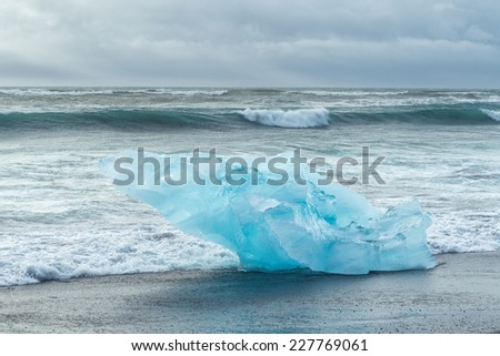 Detail view of iceberg on ocean shore, Iceland. - stock photo