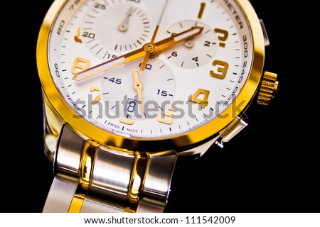 Detail view of luxury swiss watch on a black background - stock photo