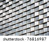 Detail view of modern city architecture with abstract patterns created by reflections and windows - stock photo