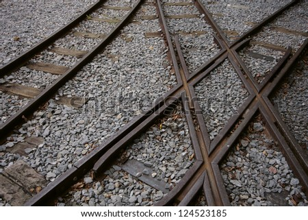 Detail view of old railroad with crossing - stock photo