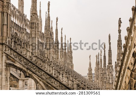 Detail view of stone sculptures on roofs of Duomo Milano, Italy