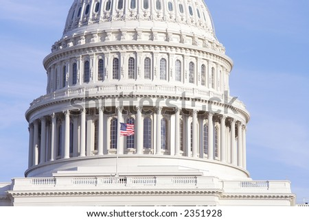 Detail view of United States Capitol dome with fluttering flag, Washington, DC.