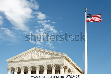 Detail view of United States Supreme Court Building and American flag, Washington, DC. - stock photo