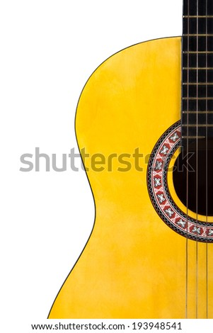 Detail view of yellow wooden classical acoustic guitar, isolated on white background. - stock photo