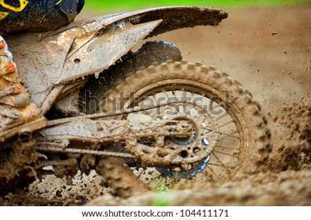 Detail view to the wheel of motocross bike.