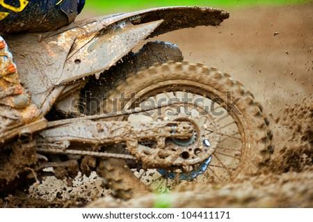 Detail view to the wheel of motocross bike. - stock photo