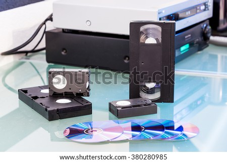 Detail views of storage media on table - stock photo