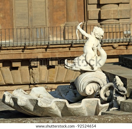 detail with  cherub sitting on dolphin from fountain in Boboli Gardens in  Florence , Unesco World Heritage site, Italy, Europe - stock photo