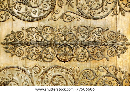Detail with metal decorations on a wooden door - stock photo