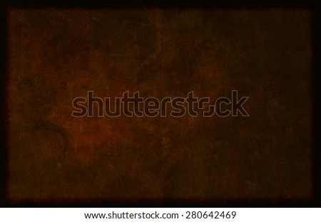 Detailed and textured dark brown background image of a simulated hide-like material. - stock photo