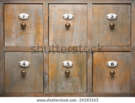 Detailed Antique Wood Filing Cabinet Drawers Image - stock photo