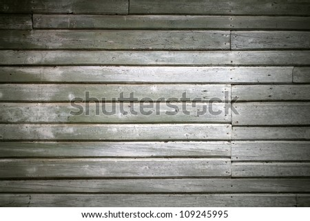 Detailed background texture of old green wall made of wooden lining boards - stock photo