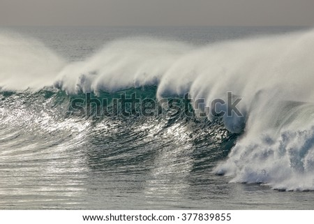 Detailed big breaking wave with spray. North of Portugal. - stock photo