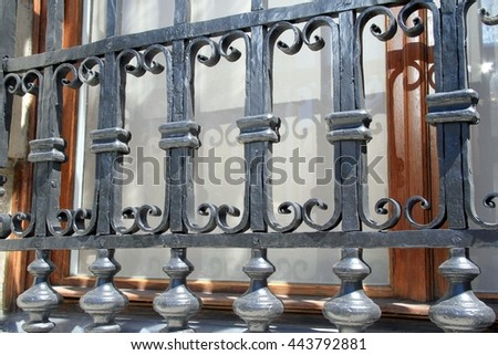 Detailed close-up of an old wrought iron window grating