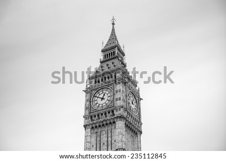 detailed close-up of Elizabeth Tower (Big Ben Clocktower) in front of gray cloudy sky, black and white, London, United Kingdom, Europe - stock photo