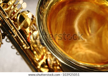 Detailed close up of saxophone bell with keys behind - stock photo