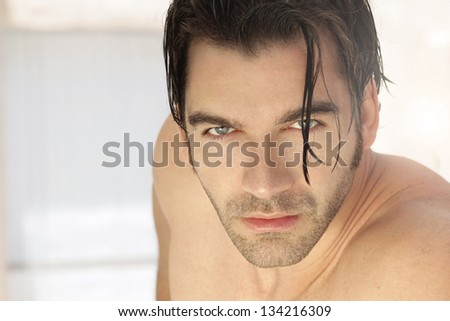 Detailed close-up portrait of a shirtless beautiful male model - stock photo