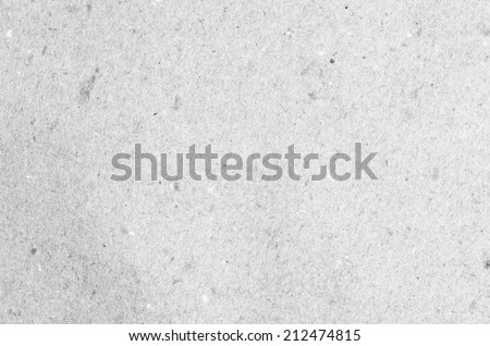 Detailed closeup of a grey cardboard texture background. - stock photo
