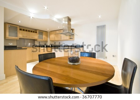 detailed dining area and kitchen in a back round