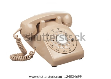Detailed image of a old rotary phone on white surface. - stock photo