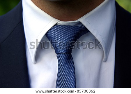Detailed image of a perfect tie knot - stock photo
