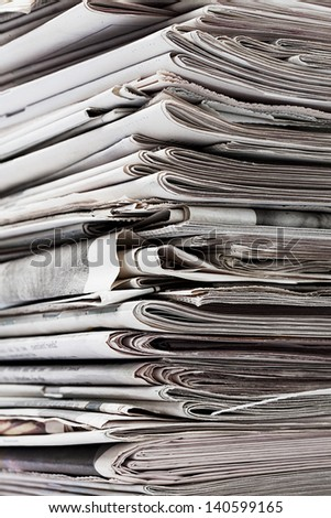 Detailed image of a stack of old newspaper for recycling. - stock photo