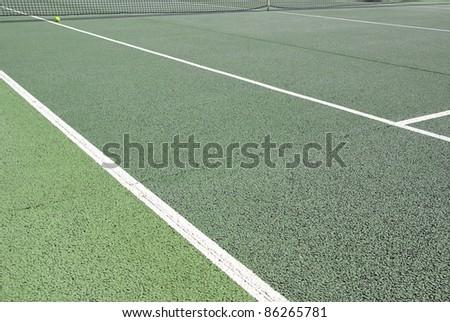 Detailed image of an asphalt tennis court - stock photo