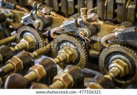 Detailed image of mechanical brass cog and ratchet mechanism.