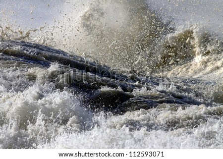 Detailed image of the foam and splashes of a great crashing wave - stock photo