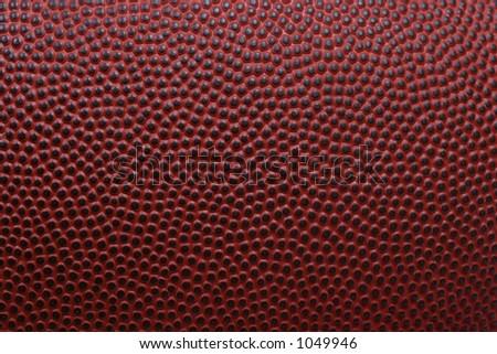 Detailed macro of american football - stock photo