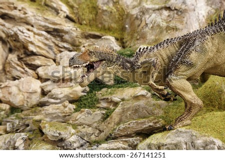 detailed miniature mountain model with dinosaur
