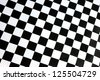 detailed pattern of black and white checkered flag at the start - stock photo