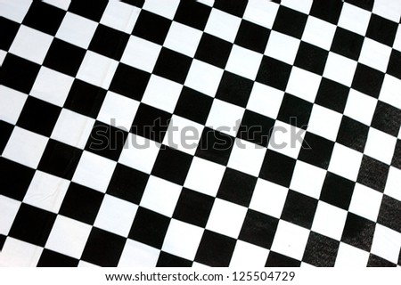 detailed pattern of black and white checkered flag at the start