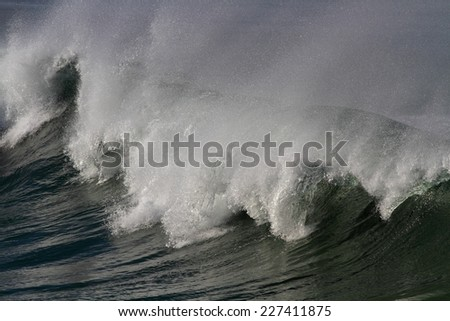 Detailed photo of a huge breaking wave. North of Portugal. - stock photo