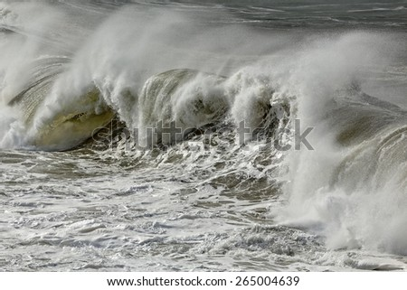 Detailed photo of a stormy breaking wave - stock photo