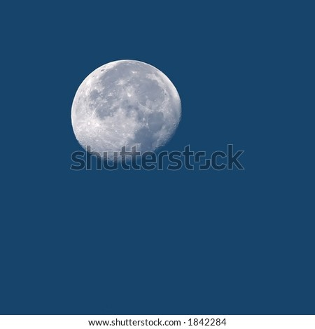 Detailed Photo of Full Moon in Daylight with Copy Space - stock photo