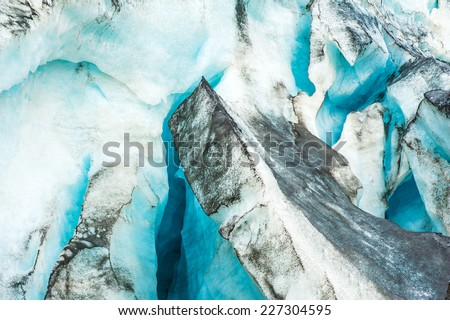 Detailed photo of the Icelandic glacier ice with a incredibly vivid colors and a nice texture - stock photo