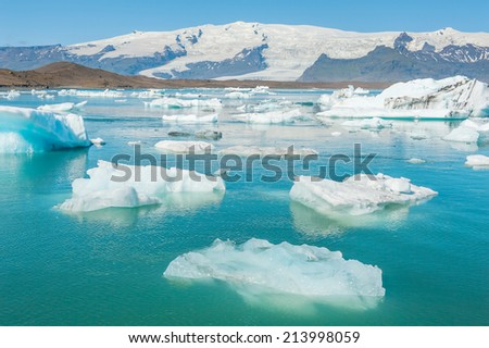 Detailed photo of the Icelandic glacier icebergs in a ice lagoon with vivid colors and a nice texture - stock photo