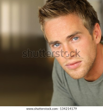 Detailed portrait of a handsome young confident man with copy space - stock photo