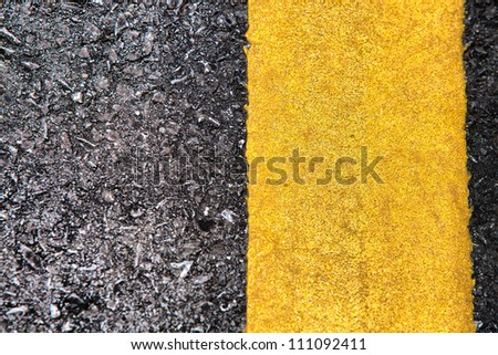 Detailed road texture with yellow stripe