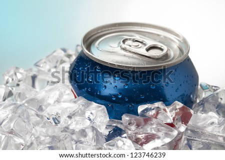 Detailed shot of blue cola can in ice cubes. - stock photo