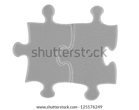 Detailed shot of grey puzzle piece against white background. - stock photo