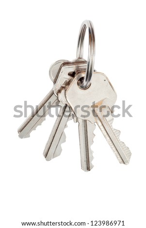 Detailed shot of metallic keys and key ring isolated over white background. - stock photo