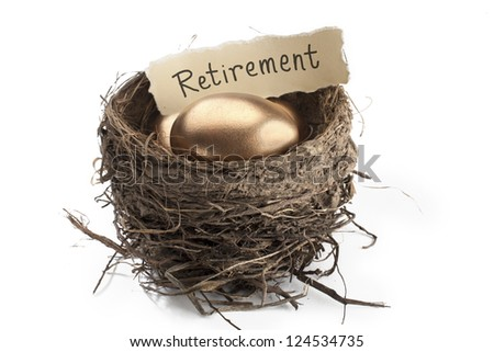 Detailed shot of shiny golden eggs with retirement paper in animal nest against white background. - stock photo