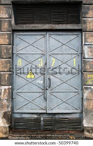 Detailed texture of a metal gray electric power substation gate