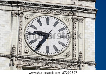 Detailed tower clock with blue sky background in USA